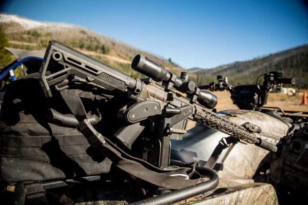 An AR-15 is mounted in a Blac-Rac 1070, installed on an ATV using a Blac-Rac Tube mount.