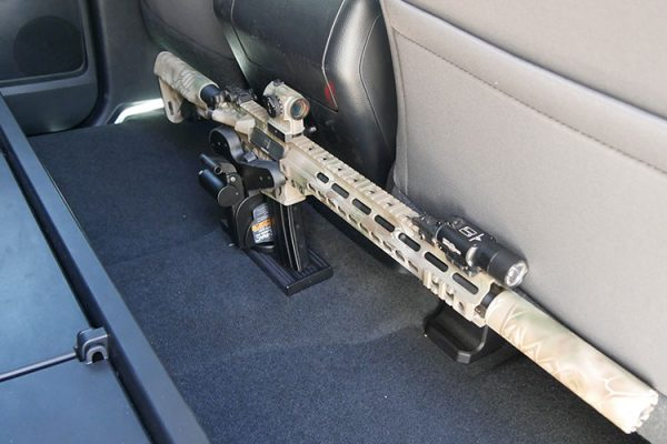 """An AR-15 is held in a Blac-Rac 1070 with an integral lock on a 10"""" T-channel. The T-Channel is mounted to the floor of a Toyota Tundra pickup truck."""