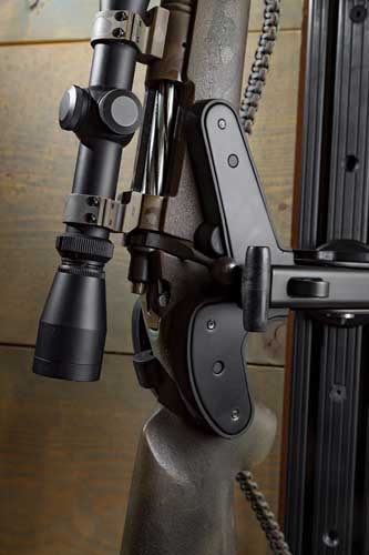 """A conventional stock rifle mounted on a Blac-Rac 1070 Weapon Retention System, wall mounted on an 18"""" T-channel."""
