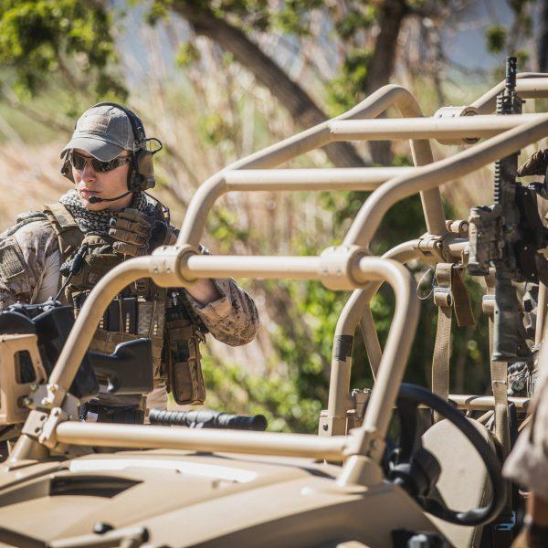 1070 gun rack mounted in utv holding ar15