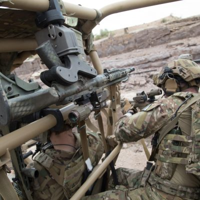soldiers sighting in a target from utv with a 1082 gun rack mounted overhead holding ar15
