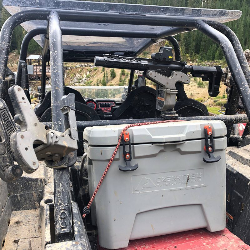 two 1082 gun racks were plunged through mud in the back of a utv