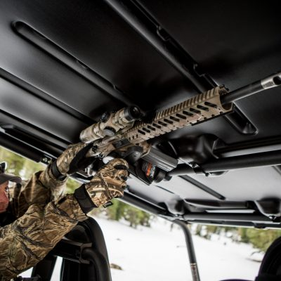 A hunter removes an AR-10 from a Blac-Rac 1070 mounted in a UTV.