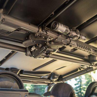 overhead mounted 1070 gun rack holding ar15 in utv