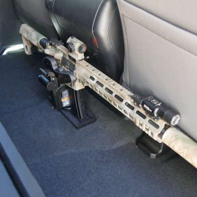 floor mounted t-channel holding 1070 gun rack in toyota tundra with ar15