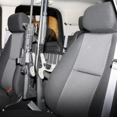 using a freestand two blac-racs are securing a shotgun and rifle in a suv police cruiser