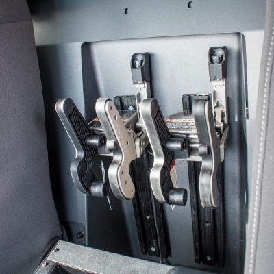 partition mounted 1082 gun racks in police cruiser